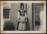 Snapshot of teacher Miss Bryant and student in front of Pierceton School, Pierceton, Ind., ca. 1930