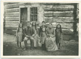 Daniel and Emma Sophia (Snoke) Eberly family in front of log cabin, Tippecanoe Township, Kosciusko...