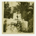 Portrait of Two Girls in White Sitting on Limestone