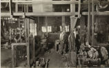 Inside of a mill showing a variety of stone working tools