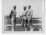 Capt. R. J. Brown, Lt. F. Woodzall, and Lt. S. G. Costine Conversing