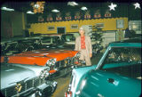 "Laughner Chrysler Dealership: Albert M. ""Prep"" Laughner with new cars"