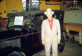 "Laughner Chrysler & Plymouth Dealership: Albert M. ""Prep"" Laughner with a 1900s car"