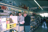 Western Auto Store: Jim R. Smith, owner, with unknown customers