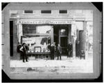 Byron Connolly and Others in Front of Star Clothing House Storefront