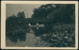 People in a Canoe by Bridge Near Pickwick Park