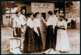 Photograph of a Group of People at the Smallest Post Office in the United States