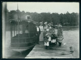 "Group of People on a Pier About to Board the ""Minnehaha"" Steamboat"
