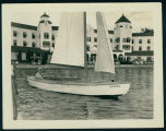 "Paul Pollock in the ""Sandra"" in Front of the Spink Wawasee Hotel"