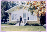 Russell R. Hirschman in Front of the Remodeled Hirschman Cottage