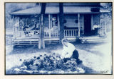 Woman Gardening Outside of Camp Comfort