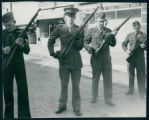 Veterans Day photo of King, Connolly, Darr, and Willcox Loading Rifles for a Gun Salute During...