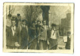 Group of young men standing on Main street across from Grace Lutheran Church