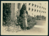 Woman Standing by Spink Hotel