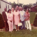 Dr. and Mrs. Rochelle in center with unknown people, July 1976
