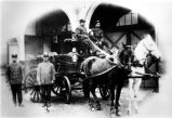 Firemen on wagon, 1920