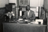 Charles Rochelle with award, Feb. 1953