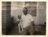 Charles Rochelle and his dog Tinker, August 14, 1963