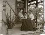 People in hammock on porch, New Harmony, IN