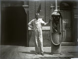 Richard Wardelmann near gasoline pumps at Wardelmann & Son Garage, New Harmony, IN