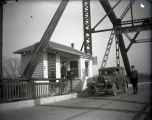 Harmony Way Bridge toll house with Mose Day, the collector, and Walter B. Wease at the register,...