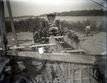 Harmony Way Bridge construction showing Dick Dunn pouring concrete in pier on Illinois side, White...