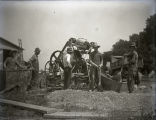 Harmony Way Bridge construction showing men with concrete mixer, New Harmony, IN