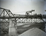 Harmony Way Bridge construction showing crane ready to move through spans with A frame dropped,...