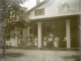 Millie Cox, Rachel Fauntleroy, Ethel Preaus, and Bessie Broadwell Brown sitting on the porch at...