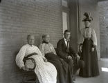 William, Rachel, Mary Emily, and Ellen Fauntleroy, on front porch of the tavern, New Harmony, IN