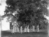 Walnut Grove District No. 4 schoolhouse with young women, New Harmony, IN.